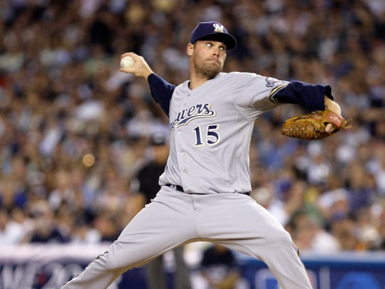Milwaukee Brewers' Ben Sheets pitches during the first