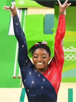 Simone Biles and the American women got off to a strong start Sunday in gymnastics team qualifying.