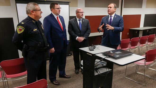 Casey Gwinn, right, president of the Family Justice Center Alliance, talks about creating a Family Justice Center in Greene County along with, from left, Chief Paul Williams, Prosecuting Attorney Dan Patterson and Sheriff Jim Arnott.