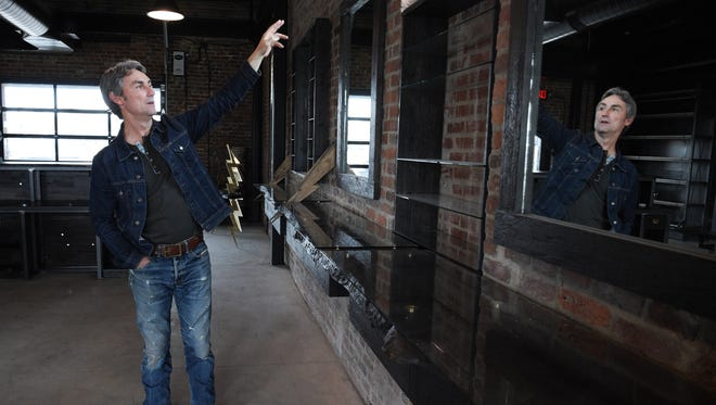 Just a block away from Mike Wolfe's Antique Archaeology store, a 1898 brick building on Jo Johnston Avenue has been renovated by the creator of the History Channel's American Pickers show.  Wolfe gives a tour of the his building on Thursday. March 30, 2017. Restoration work started on dilapidated brick building in Nov. 2014.