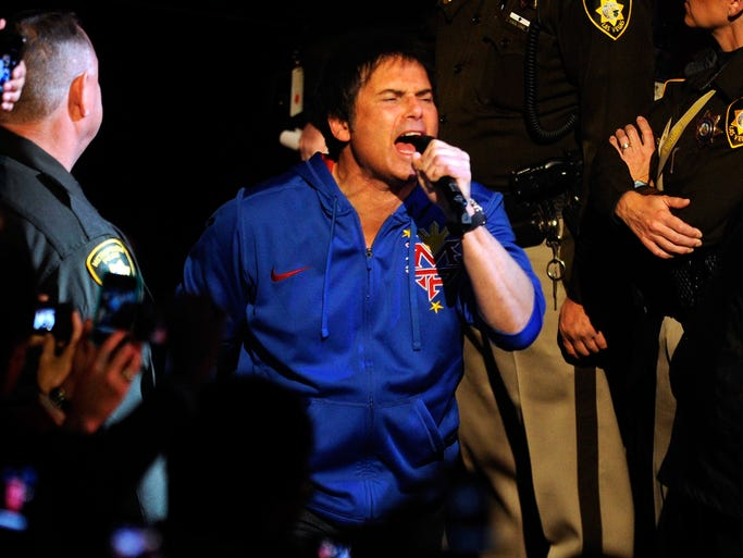 "LAS VEGAS, NV - NOVEMBER 12:  Singer Jimi Jamison performs Survivor's song ""Eye of the Tiger"" as boxer Manny Pacquiao walks out to the ring to take on Juan Manuel Marquez in the WBO world welterweight title fight at the MGM Grand Garden Arena on November 12, 2011 in Las Vegas, Nevada.  (Photo by Ethan Miller/Getty Images)"