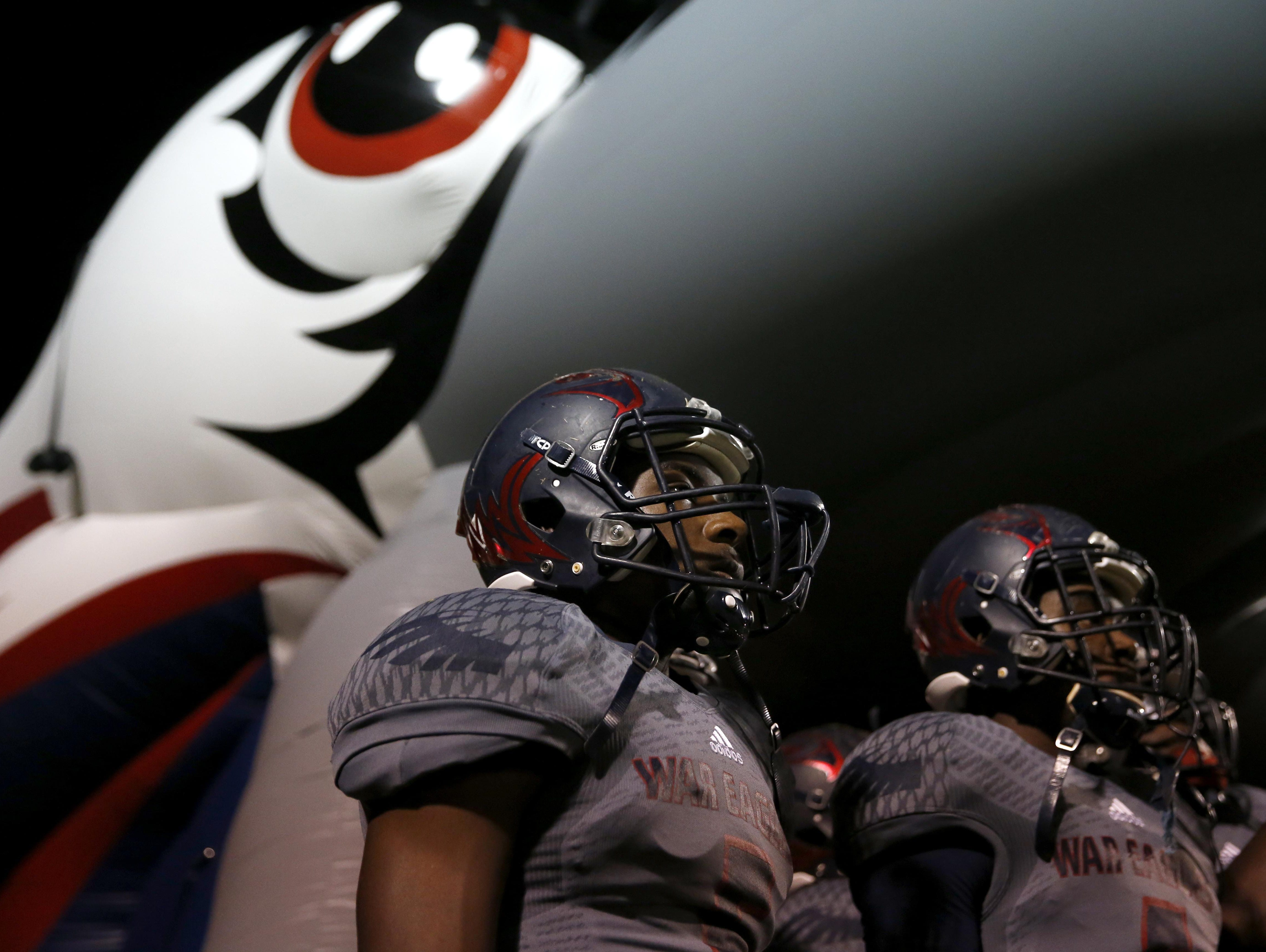 Wakulla's Justin Davis, left, and Cephus Greene wait to charge on to the field before they take on Rickards in a playoff game on Friday.