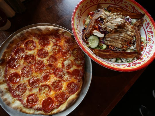 A pepperoni pizza and the Gatwyns II Grilled Chicken Salad. The restaurant, a 19-year-old classic American pub located in Jefferson. August 3, 2016, Jefferson, NJ
