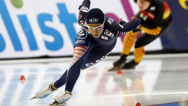 Lee Sang-Hwa of Korea, left, races Jenny Wolf of Germany in the 500 meter during the Essent ISU speedskating World Cup at Utah Olympic Oval.