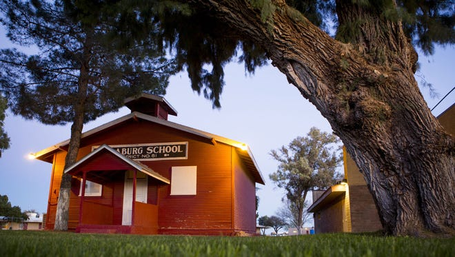 A red schoolhouse built in 1921 is part of the Nadaburg Unified School District, a cash-strapped district in the Far West Valley.
