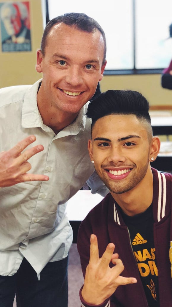 South Kitsap baseball coach Marcus Logue and senior Dusty Garcia make the pitch fork sign on Wednesday after Garcia signed a National Letter of Intent with Arizona State University.