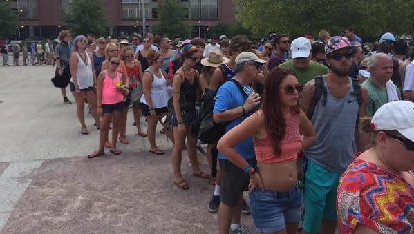 Long line outside gates of Forecastle. Friday night storm delayed Saturday's opening.