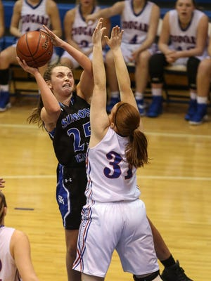 Simon Kenton's Ally Niece puts up an off balance shot against Brianna Roberts of Conner during their game at Conner, Thursday, January 26, 2017.