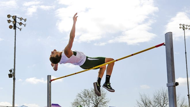 Fossil Ridge's Tyler Russel clears 6 feet, 8 inches to win the Class 5A boys high jump title Thursday.