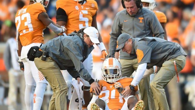 Tennessee trainers attend to Tennessee linebacker Darrin Kirkland Jr. (34) during the first half at Neyland Stadium against Missouri on Saturday, Nov. 19, 2016.