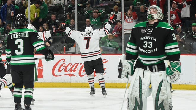 St. Cloud State's Nick Poehling celebrates his goal in overtime against North Dakota goaltender Cam Johnson to give SCSU the 3-2 win in the first game of the NCHC Frozen Faceoff Friday, March 16, at the Xcel Energy Center in St. Paul.