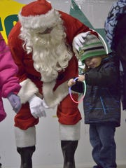 Santa Claus made his usual entrance and spent time with the kids.
