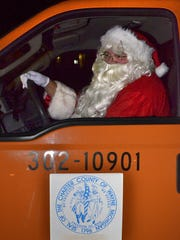 Apparently, Santa Claus parked the sleigh and reindeer and took a county truck.