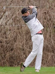 Following through is Max Proulx of Livonia Churchill.