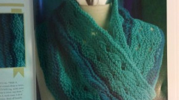 I love this cowl. It's lacy and warm at the same time.