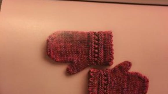 These children's mittens are knitted in the round.