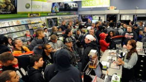 "A crowd gathers to buy copies of ""Call of Duty: Modern Warfare 3"" during a launch event for the highly anticipated video game at a GameStop Corp. store November 7, 2011 in North Las Vegas, Nevada."