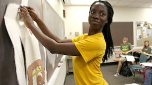 Baylor student Joanne Sonaike practices locating organs on the body using the Spanish terms.