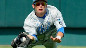 UCLA center fielder Beau Amaral makes a diving catch during the 2010 NCAA College World Series.