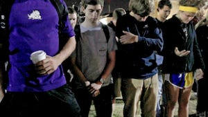 Supporters of Texas Christian University pray at Frog Fountain on campus Wednesday night, Feb. 15, 2012 as a reaction to Wednesday's drug-related arrests on campus.