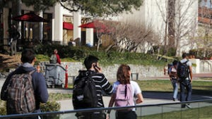 In this Thursday, Feb. 2, 2012 photo, students walk through the campus of Claremont McKenna College in Claremont, California.