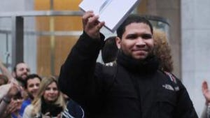The first customer to purchase the new iPad at the Fifth Avenue Apple store emerges as the tablet went on sale in New York City.