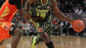 MVP Shabazz Muhammad drives against Alex Poythress of the East team during the 2012 McDonald's All American Game.
