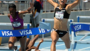 Lolo Jones (right) celebrates after winning the women's 100m hurdles at the USA Track & Field Championships.