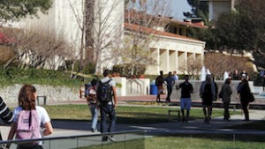 students walk through the campus of Claremont McKenna College in Claremont, Calif.