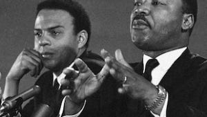 In this Feb. 7, 1968 file photo, Dr. Martin Luther King Jr., center, speaks to an audience. King, who was president of the Southern Christian Leadership Conference, is shown with the Rev. Andrew Young, executive Vice President of the Southern Conference.