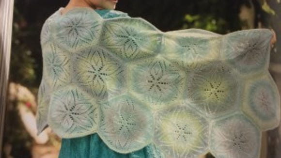 This hexagonal pattern has 22 motifs sewn together. It's called the Sand Dollar Wrap, although sand dollars actually have only 5 points, not six.