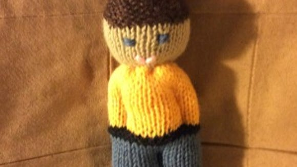 I knitted the whole doll in one night and sewed him up the next morning.