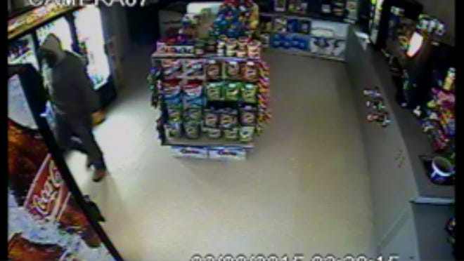 Authorities are asking for the public's help in identifying this man who they believed broke into Cedar Band Trading Post on Monday.