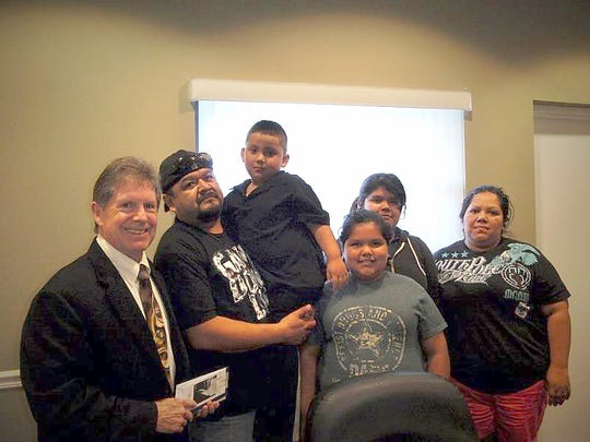 Attorney William G. Morris, left, is seen with the Santana family.