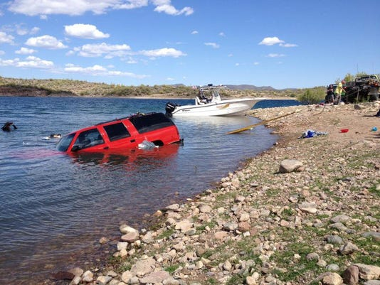Car rolls into lake