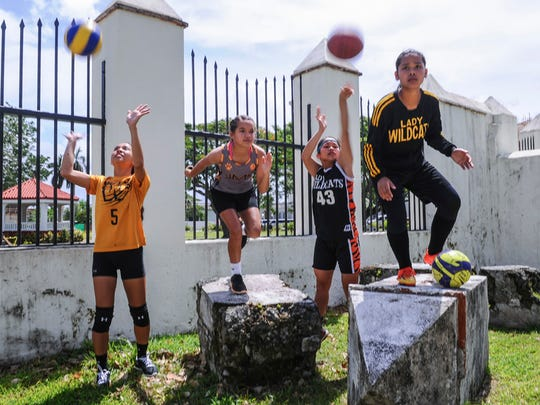 Athletes of the Untalan Middle School Lady Wildcats gather for a photo at the Plaza de Espana in Hagatna on June 11. From left, Isla Quinata, Jacquelyn Cabusi, Bila Aguon and Kamrie Heflin.