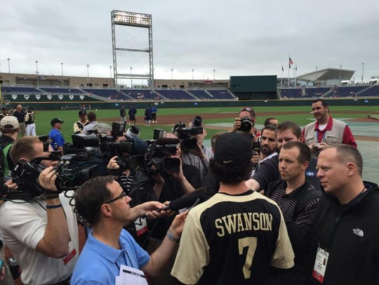 Dansby Swanson meets with the media on the field at