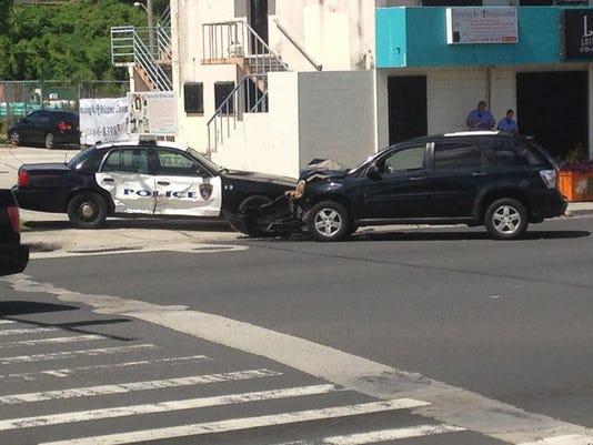 635699407332868497-cop-crash