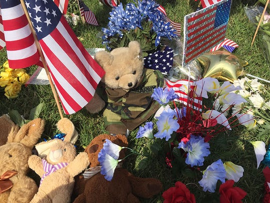 Flowers, cards and teddy bears dressed in camo were left at a memorial for the 5 men who were killed in a mass shooting in Chattanooga on Thursday.