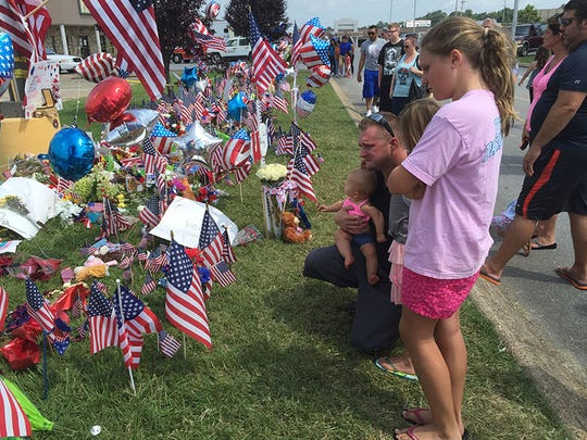 Hundreds of mourners gathered Saturday at a memorial at the site where the deadly Chattanooga shooting began.