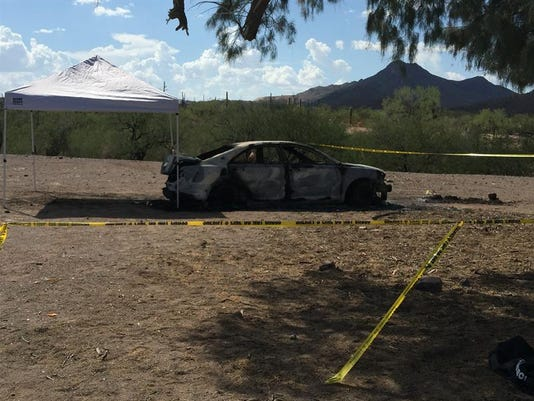 Body found in trunk of burned car