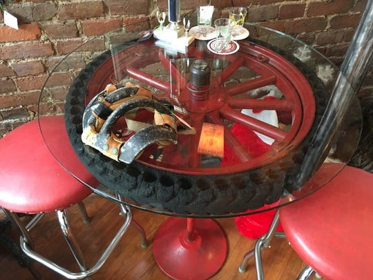 A vintage Model A automotive tire-and-wheel assembly