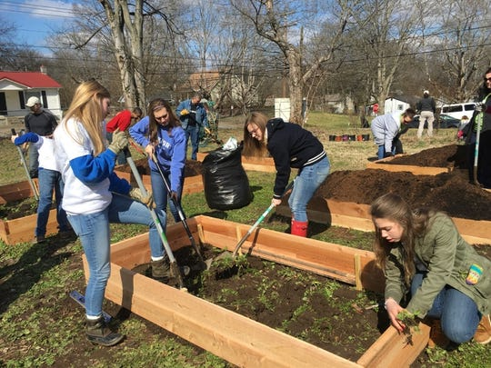 Clarksville Academy Challenge-Based Learning students such as these helped jump-start the community garden.