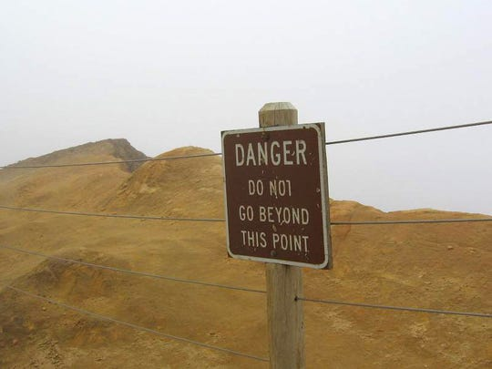 Signs at the edge of Cape Kiwanda are set to stop people from falling off the cliffs above the ocean. However, many disregard them, leading to fatal accidents.