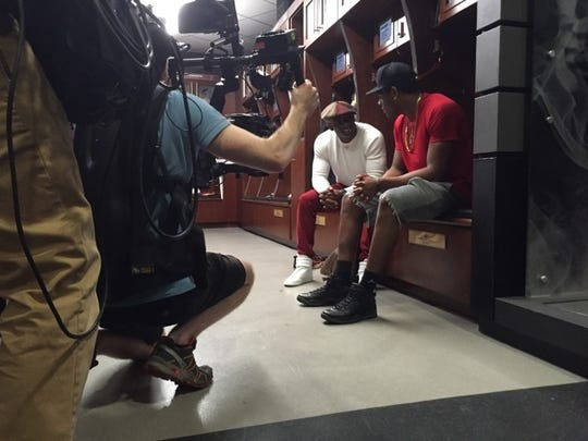 Deion Sanders talks with Jalen Ramsey inside the FSU