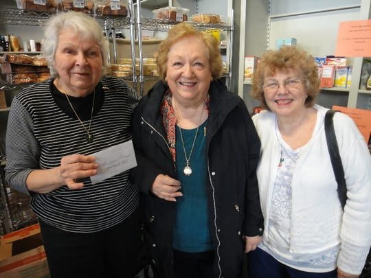 In continuing support of the Food Bank Network of Somerset County, the Bridgewater Woman's Club  Recently donated $500 to help the Food Bank carry out its mission. Pictured from left to right are Marie Scannell, Food Bank director, and Rita Coleman and Barbara Lubrani of the Woman's Club. In a separate community outreach effort, the club also donated goodie bags filled with candy, cookies, crackers, notepads and tissues donated to the Somerset County Adult Day Care Center for distribution to their participants for the Easter holiday.