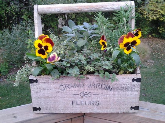 An herb garden can be spruced up with flowers.