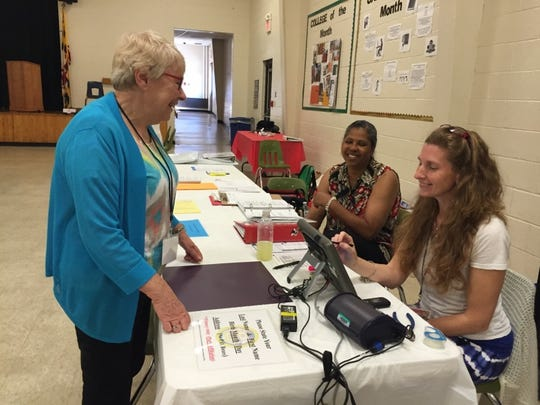 Rosemary Slacum, a volunteer at Mardela Middle and High School, prepares to cast her vote in the 2016 primary election.