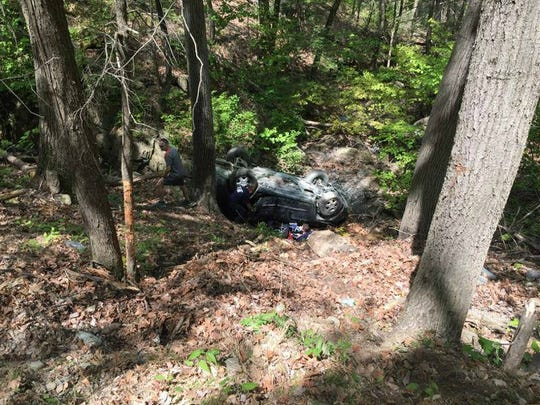 The scene of a rollover accident on Mount Beacon Friday.