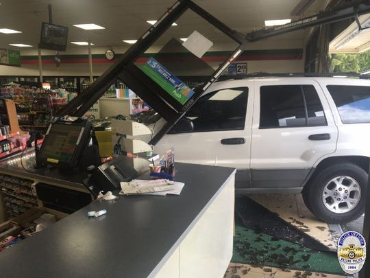 An SUV crashed into a Keizer 7-Eleven store late Friday morning.